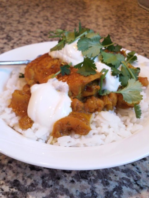 The end result: Pukka Yellow Curry garnished with sour cream and Cilantro.